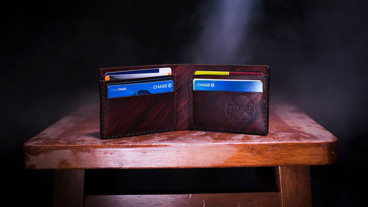 Wallet open on table with credit cards