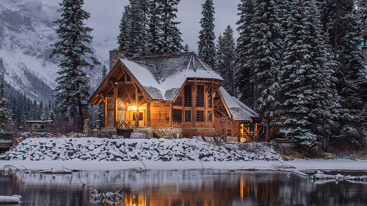Snowy cabin on a lake