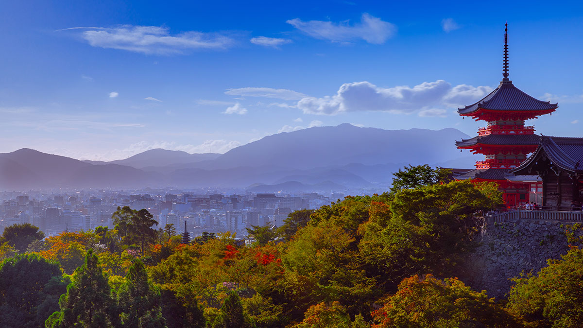 Kiyomizudera Temple with mountains and Kyoto skyline in the background